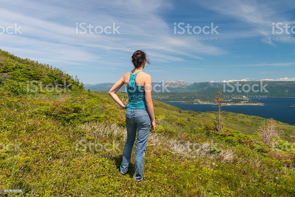 Young woman hiking in Newfoundland, Gros Morne National Park stock photo