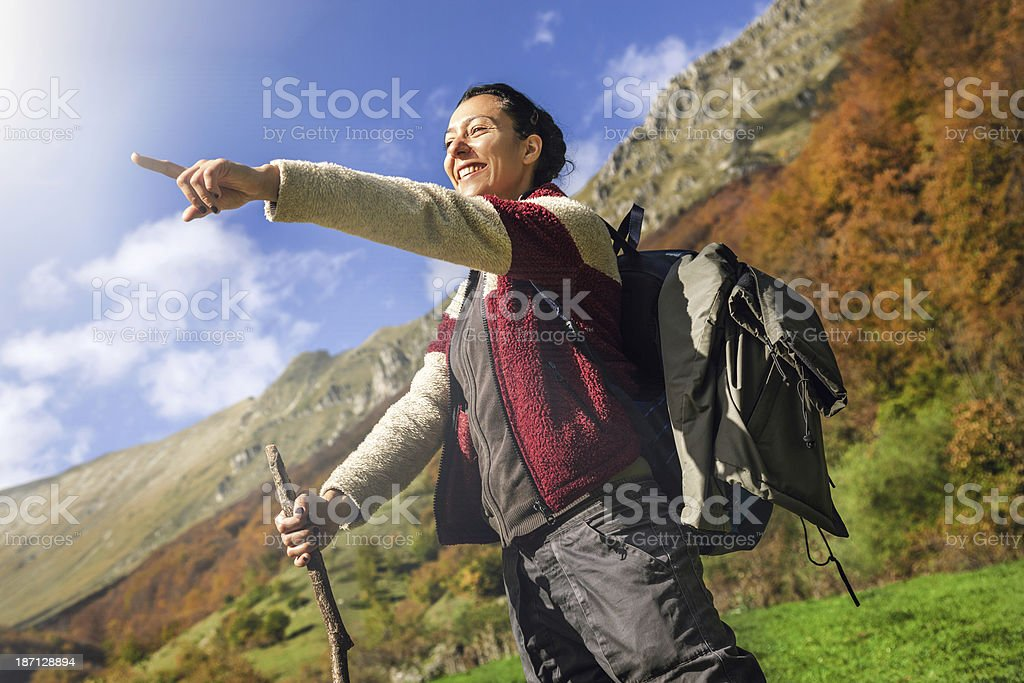 Young woman hiking in the mountains royalty-free stock photo