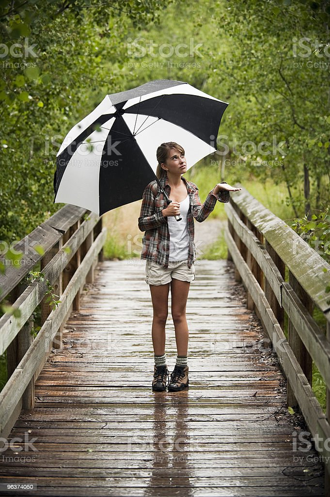 Young Woman Hiking on Rainy Day stock photo