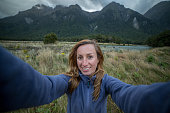 Young woman hiking takes selfie