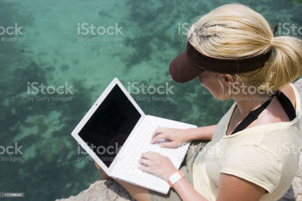 Blond Young Woman Using Laptop Outdoors, Copyspace royalty-free stock photo