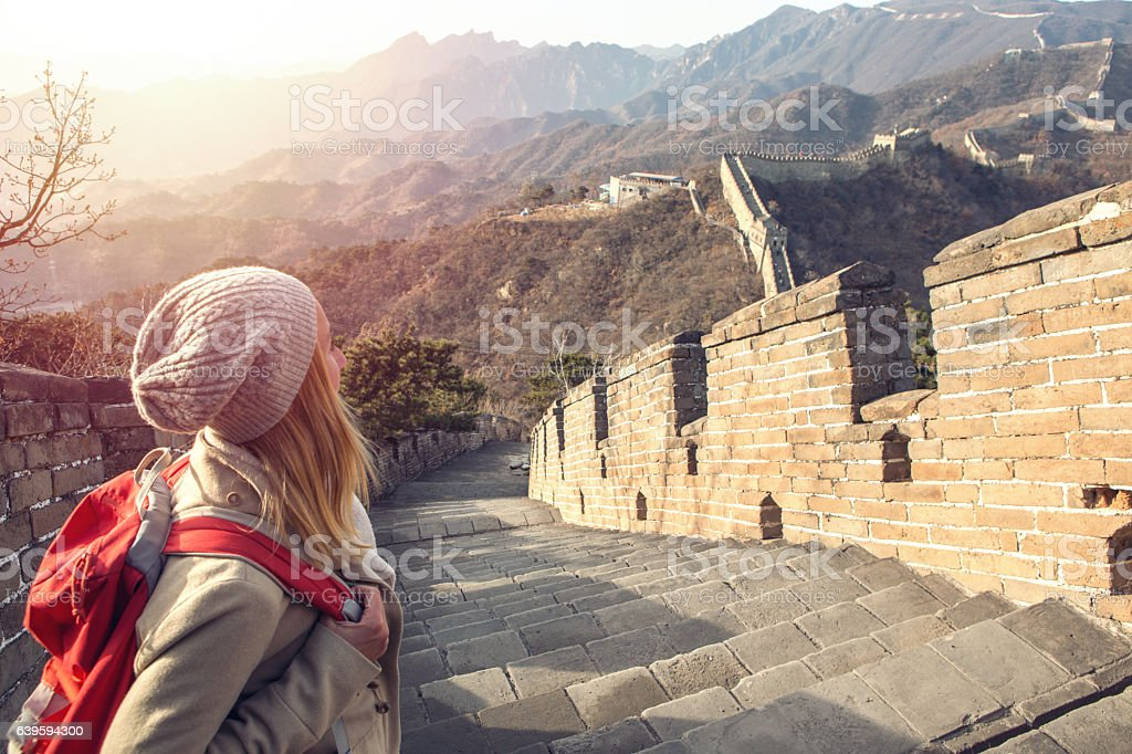 Young woman hiking the Great Wall of China stock photo