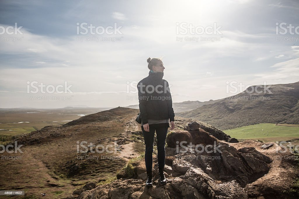 Young woman hiking the mountain in Iceland stock photo