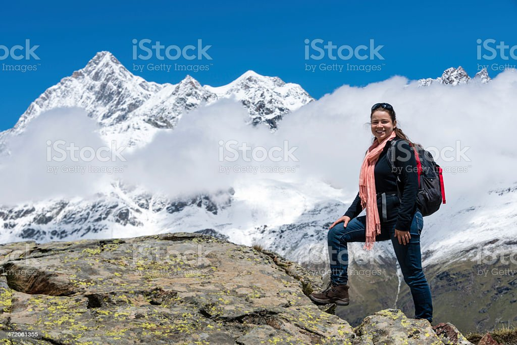 Young woman hiking with mountain range in the background -XXXL royalty-free stock photo