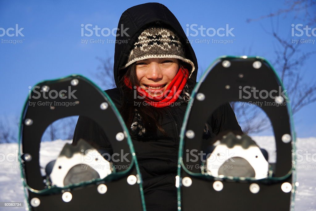 Young woman hiking with snowshoes royalty-free stock photo