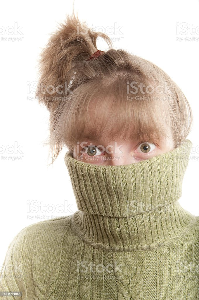 Young woman hinding face behind collar of her sweater royalty-free stock photo