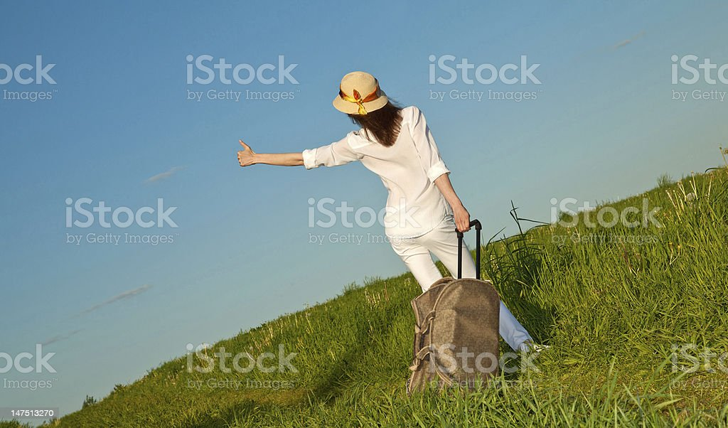 Young woman hitchhiking royalty-free stock photo