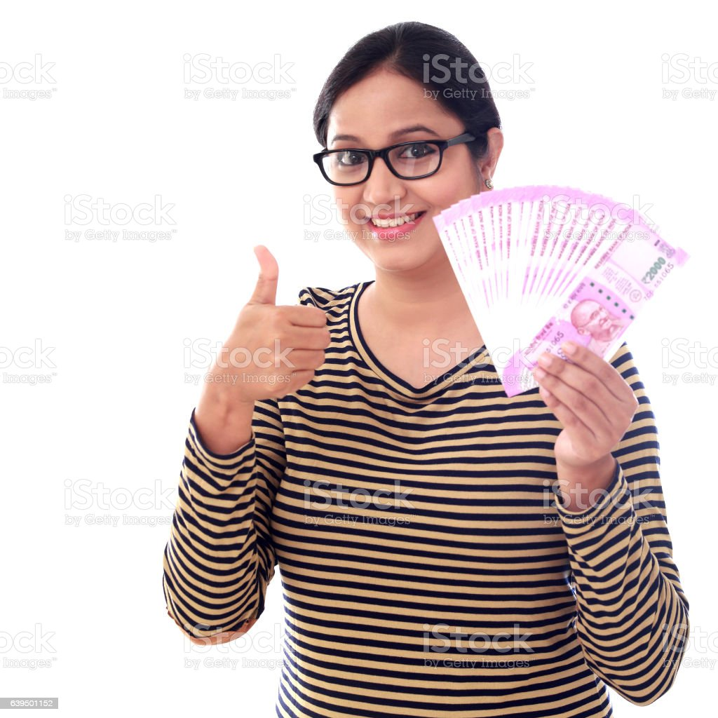 Young woman holding 2000 rupee notes stock photo