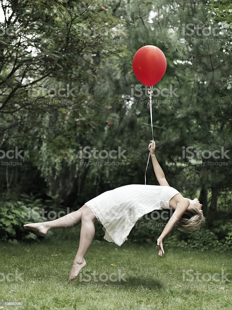 Young woman holding a balloon stock photo