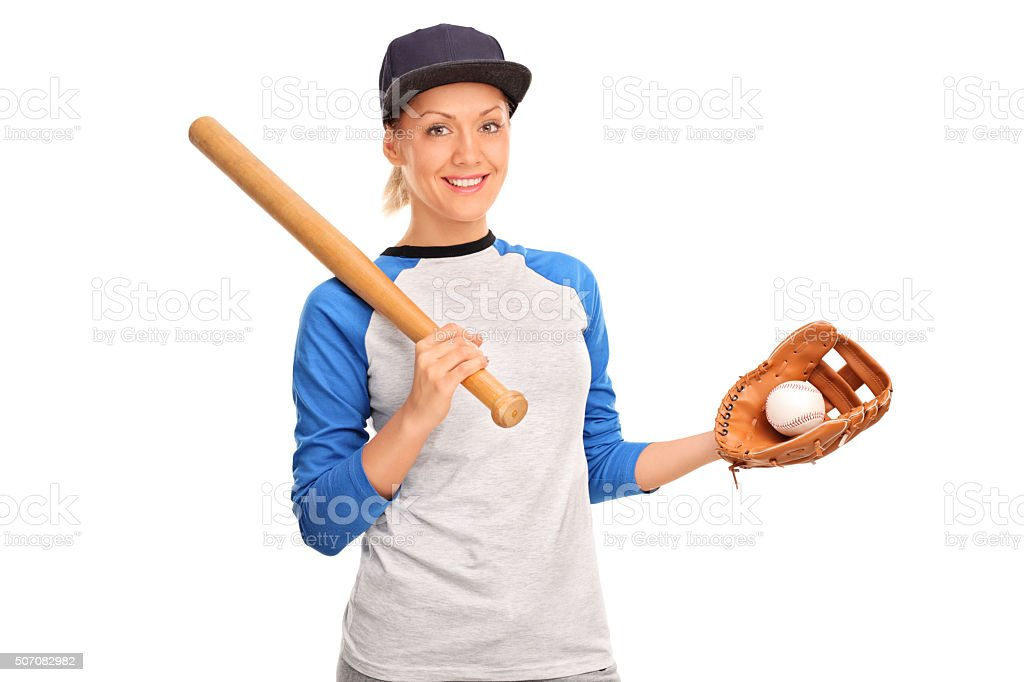 Young woman holding a baseball bat stock photo