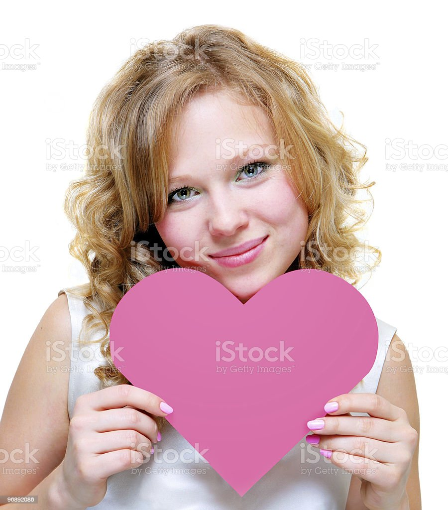 young woman holding a big pink heart stock photo