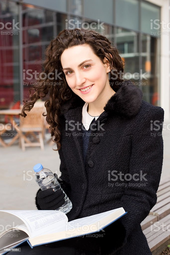 young woman holding a book and water royalty-free stock photo