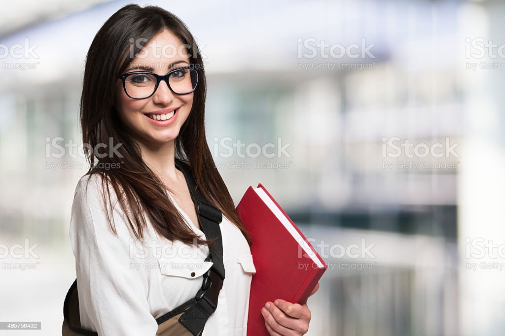Young woman holding a book stock photo