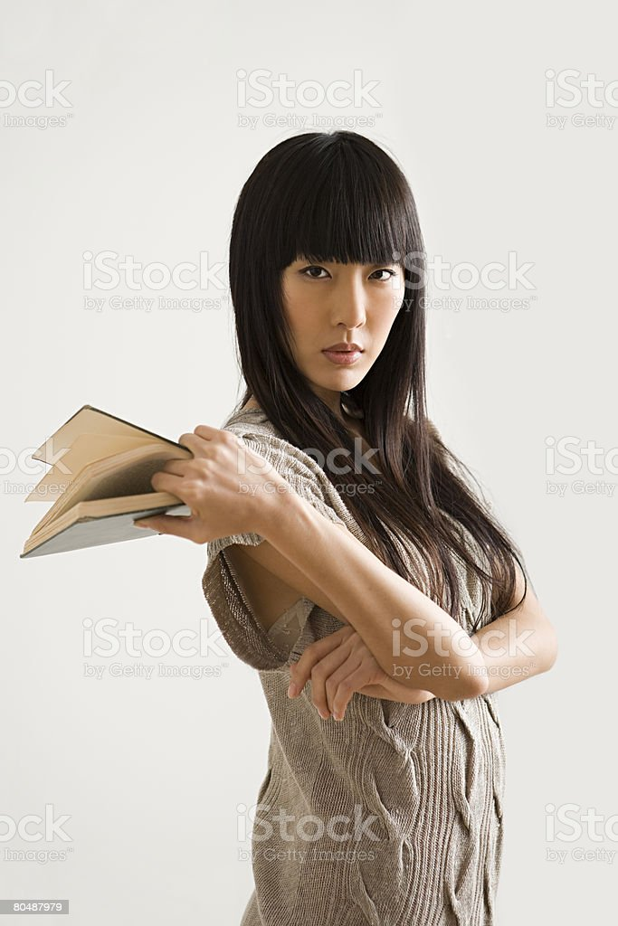 Young woman holding a book royalty-free stock photo