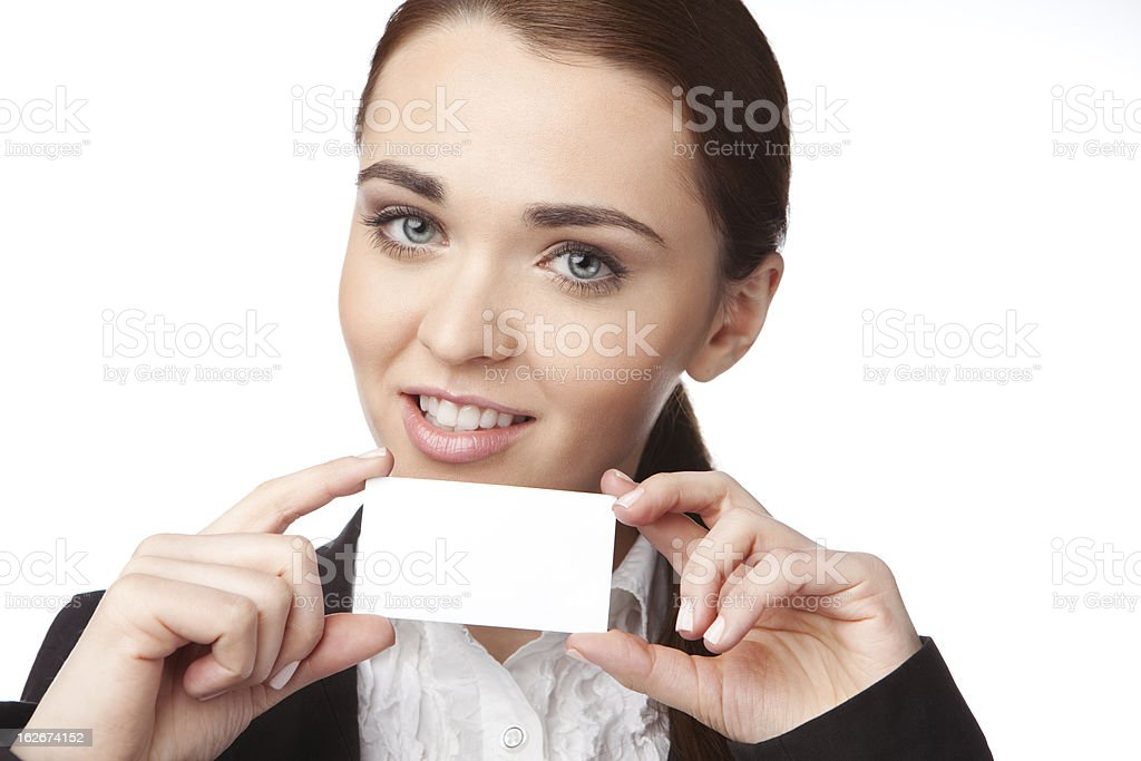 Young woman holding a business card on the white background royalty-free stock photo