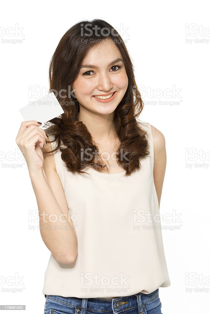 Young woman holding a card royalty-free stock photo