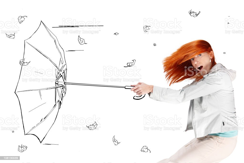 Young Woman Holding a Cartoon Wind Blown Umbrella stock photo