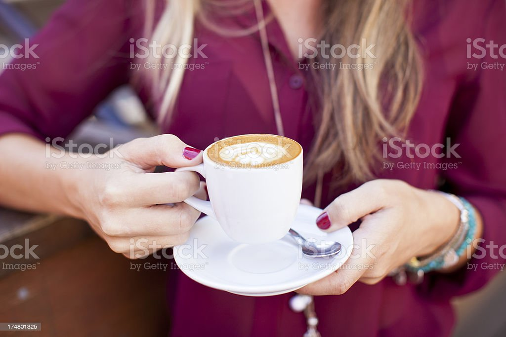 Young woman holding a cup of coffee. stock photo