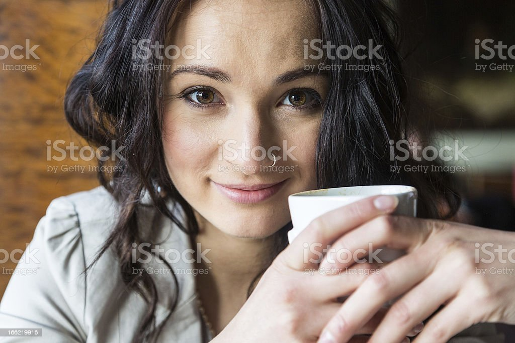 Young Woman Holding a Cup of Hot Beverage royalty-free stock photo
