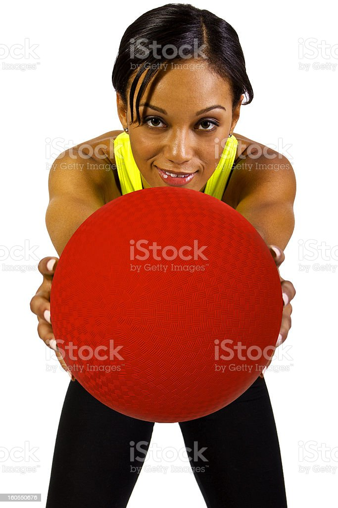 A young woman holding a dodge ball  stock photo