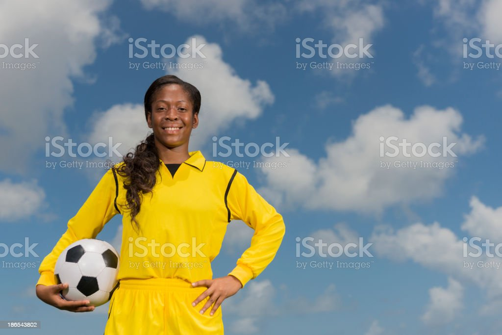 Young Woman Holding A Football stock photo