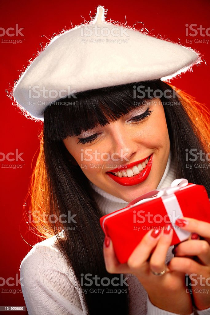 Young woman holding a gift royalty-free stock photo
