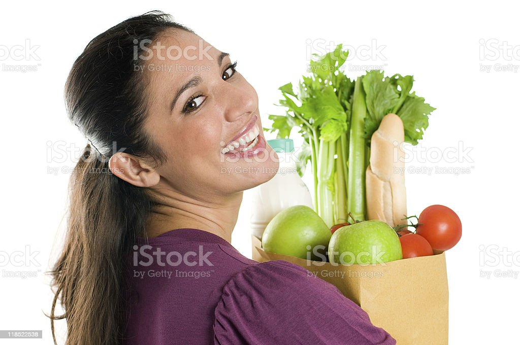 Young woman holding a grocery bag close up stock photo