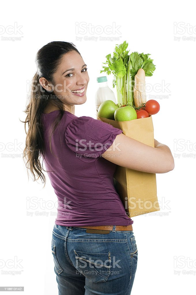 Young woman holding a grocery bag royalty-free stock photo