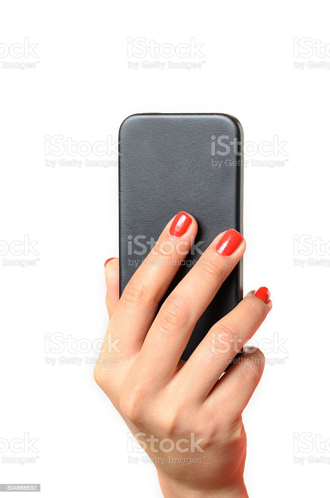 Young woman holding a mobile phone stock photo