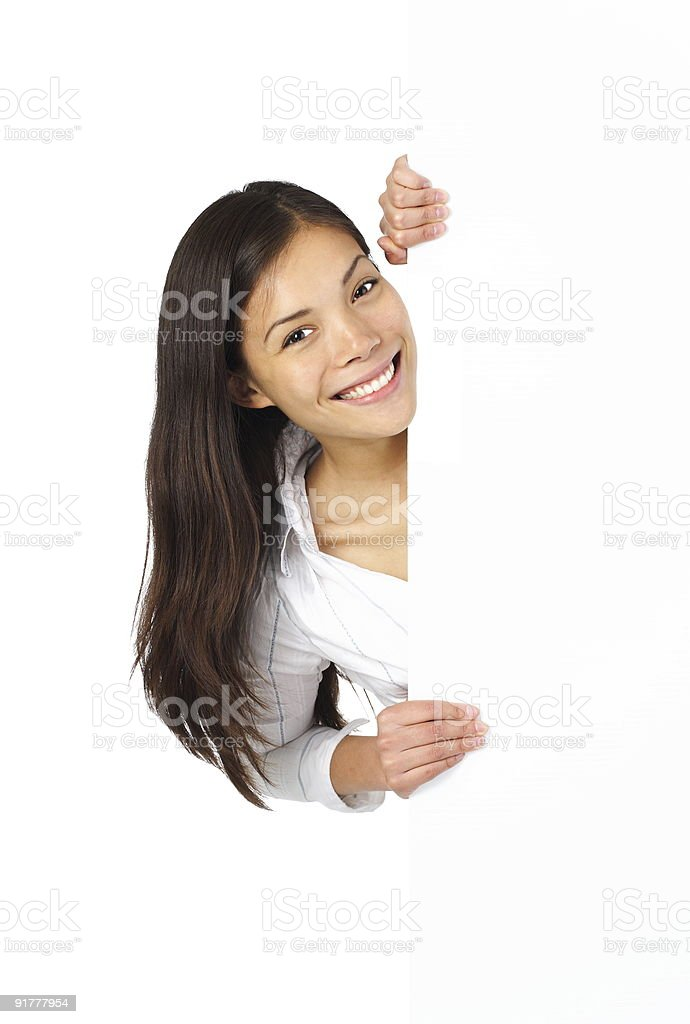 Young woman holding a plain white sign royalty-free stock photo