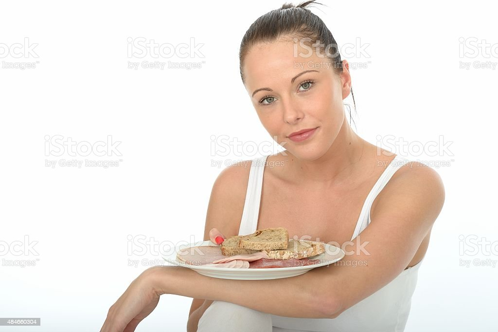 Young Woman Holding a Plate Scandinavian Style Cold Meats stock photo
