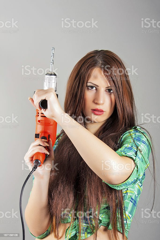 young woman holding a power tool royalty-free stock photo