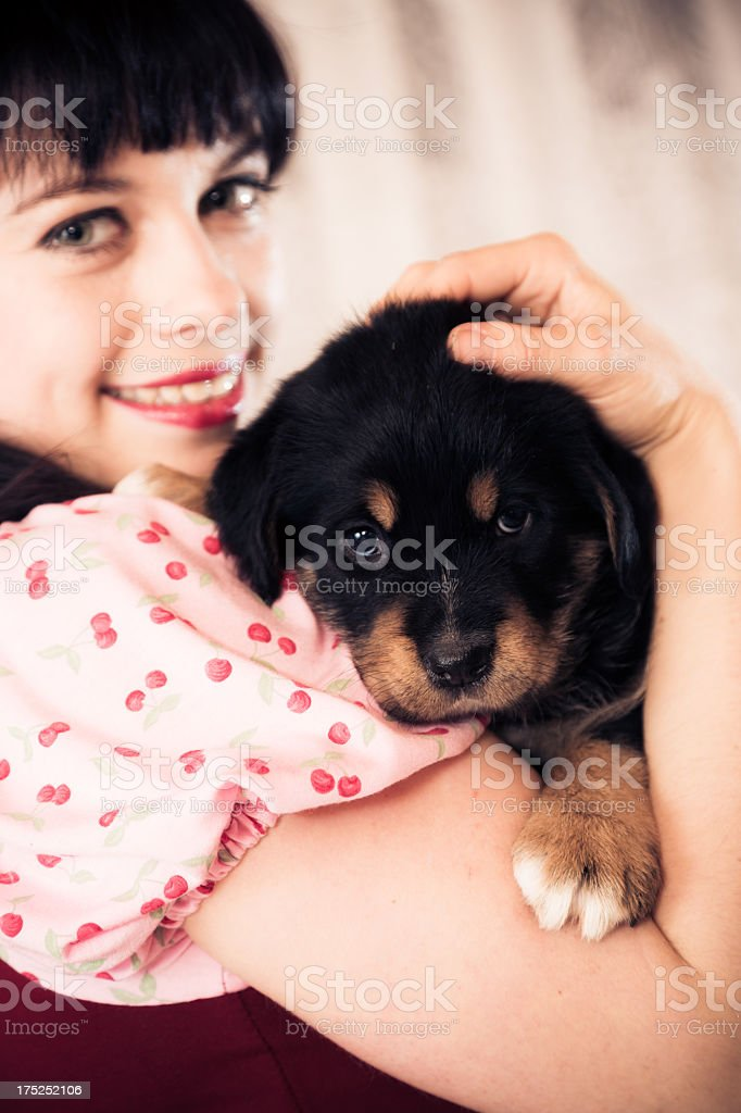 young woman holding a puppy royalty-free stock photo