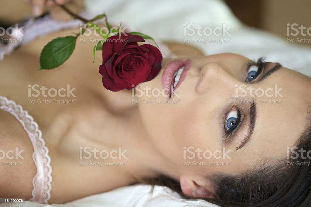 Young Woman Holding a Red Rose stock photo