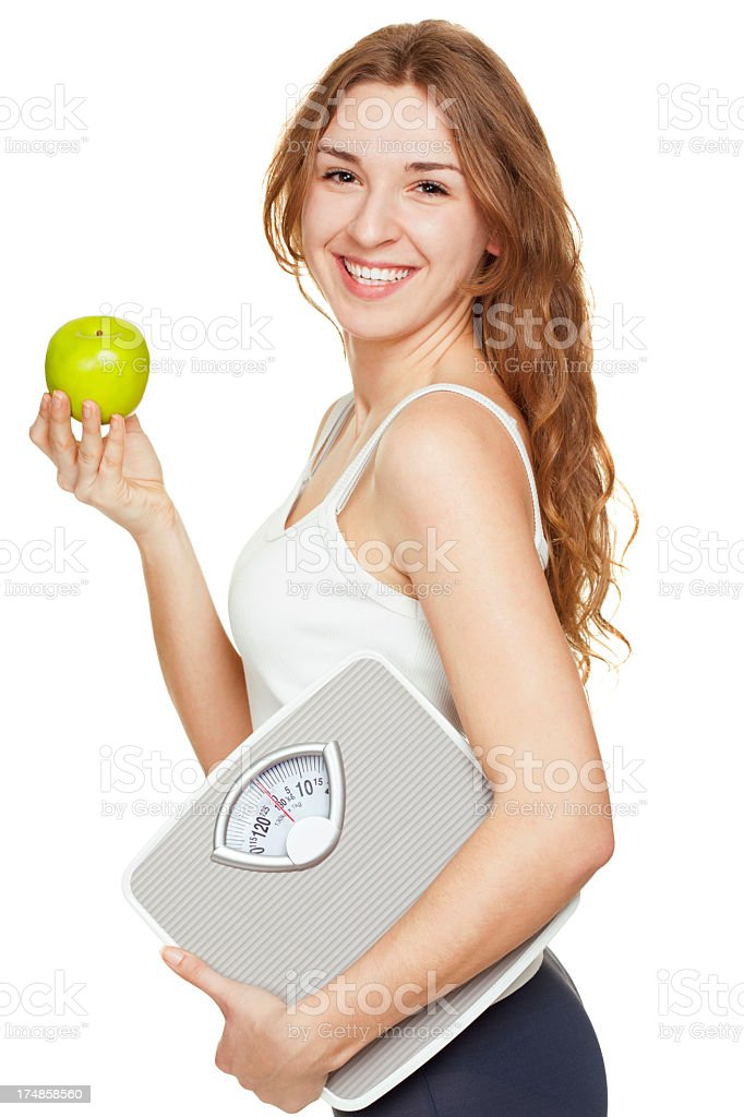 young woman holding a scale ready to eat an apple royalty-free stock photo
