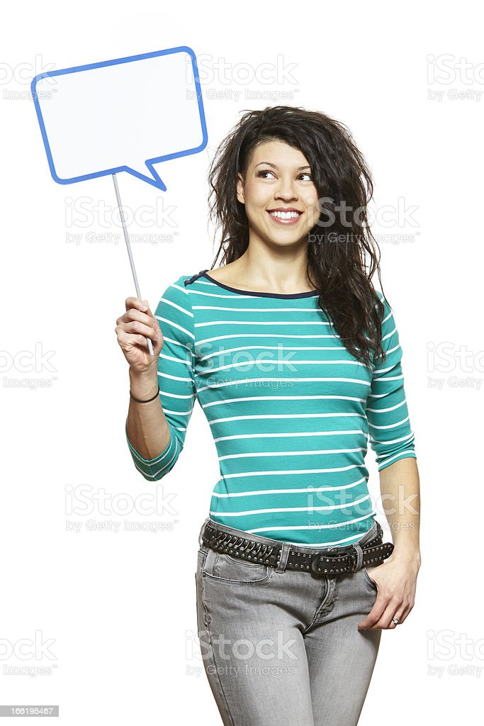 Young woman holding a speech bubble sign smiling royalty-free stock photo