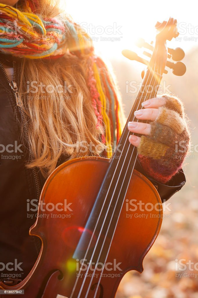 Young woman holding a violin stock photo
