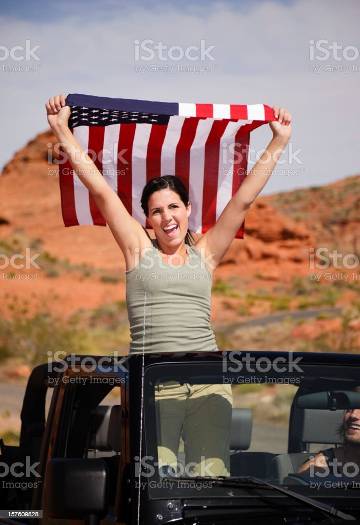 Young Woman Holding American Flag royalty-free stock photo