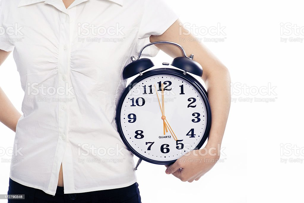 Young Woman Holding an Alarm Clock royalty-free stock photo