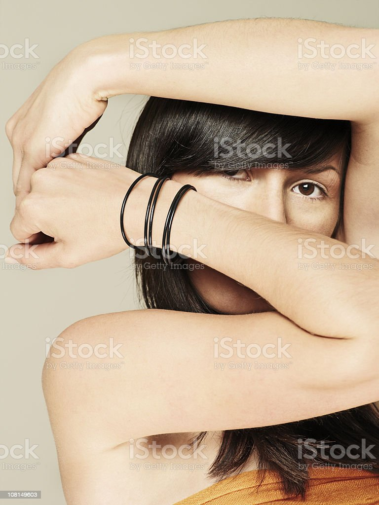Young Woman Holding Arms Across Face royalty-free stock photo