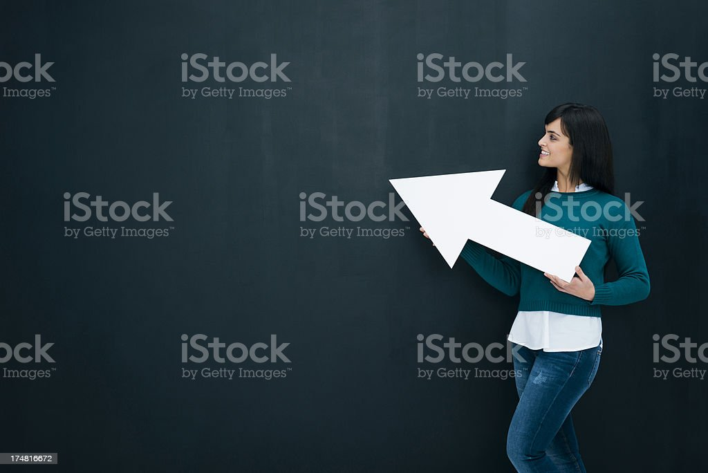 Young woman holding arrow royalty-free stock photo
