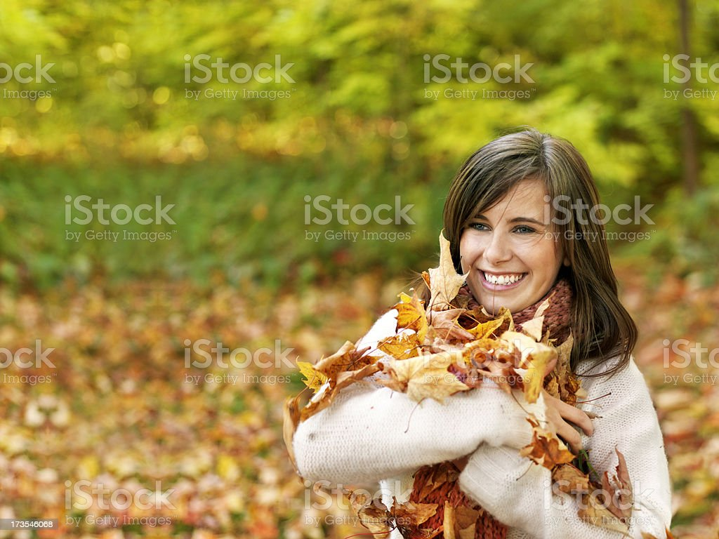Young woman holding autumn leafs royalty-free stock photo