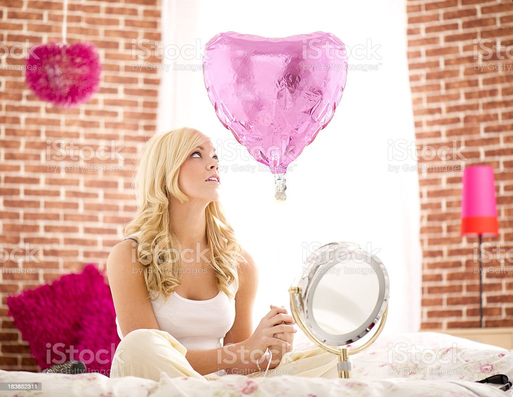 Young woman holding balloon stock photo
