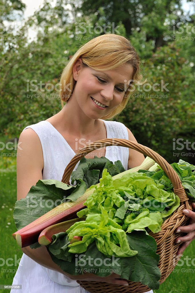 Young woman holding basket with vegetable royalty-free stock photo