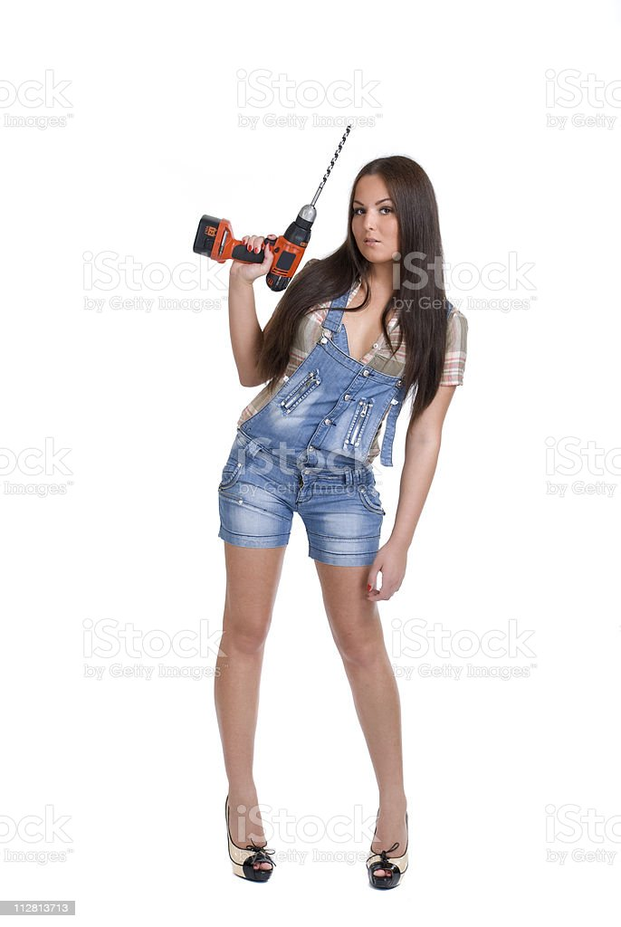Young woman holding battery drill royalty-free stock photo