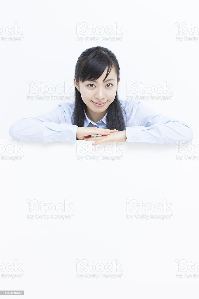 young woman holding billboard royalty-free stock photo
