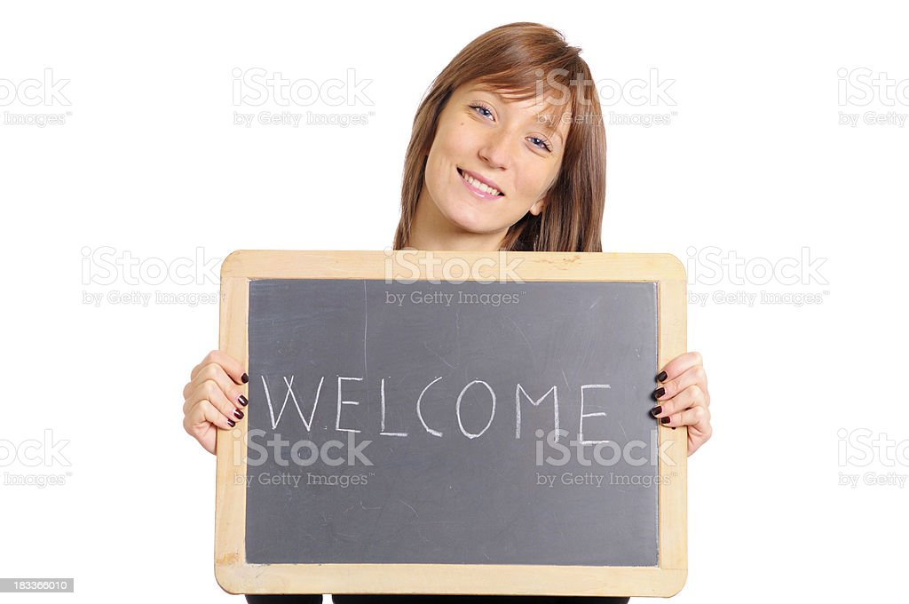 Young Woman Holding Blackboard W Welcome Message.Copy Space. royalty-free stock photo