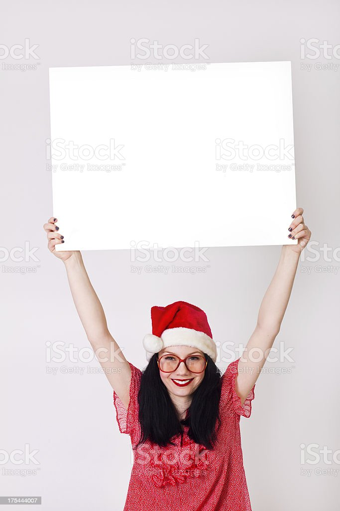 Young woman holding blank board royalty-free stock photo