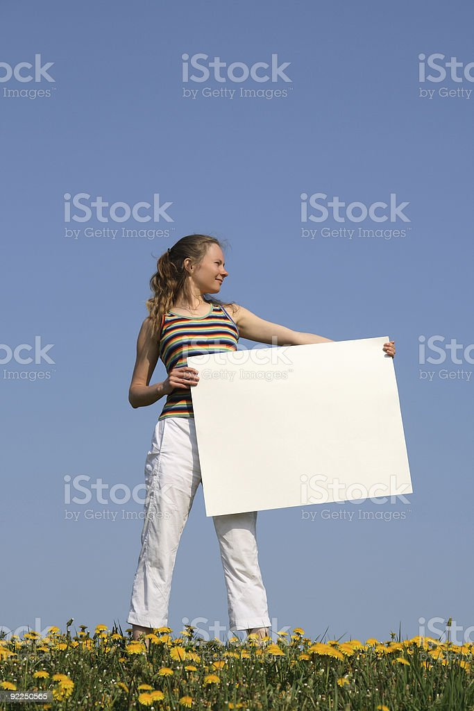 Young woman holding blank cardboard with copyspace royalty-free stock photo