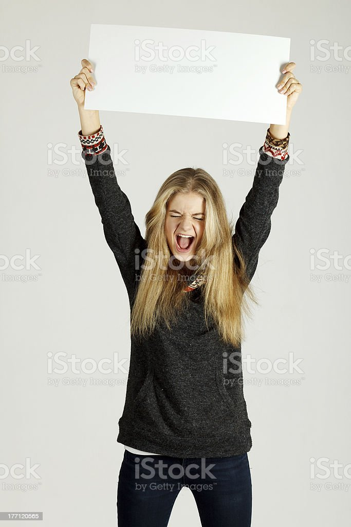 Young woman holding blank placard royalty-free stock photo